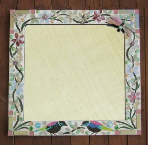 Glass mosaic mirro by Sharon Carroll, with tuis and dragonfly with white grout