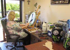 Photograph of artist Sharon Carroll at work in the studio.